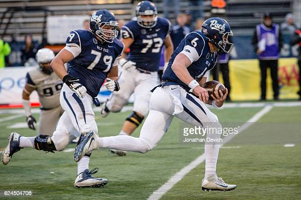 Quarterback Ty Gangi of the Nevada Wolf Pack runs the ball for a touchdown against the Utah State Aggies at Mackay Stadium on November 19 2016 in...