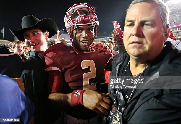 Quarterback Tyler Murphy of the Boston College Eagles needs a police escort to get off the field after their 3731 win over the USC Trojans at Alumni...