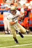 Quarterback Tyler Palko of the University of Pittsburgh Panthers looks to make a pass against the Syracuse University Orange at the Carrier Dome on...