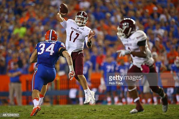 Quarterback Tyler Rogers of the New Mexico State Aggies looks to throw over linebacker Alex Anzalone of the Florida Gators during the first half of...