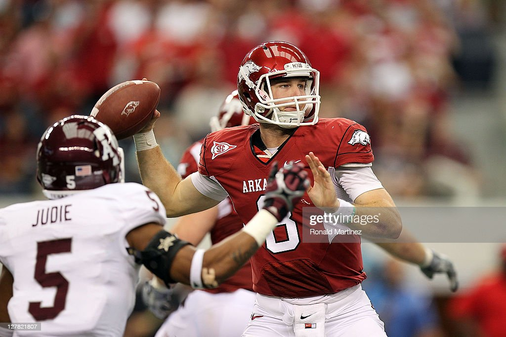 Quarterback Tyler Wilson #8 of the Arkansas Razorbacks throws against the Texas A&M Aggies at Cowboys Stadium on October 1, 2011 in Arlington, Texas.