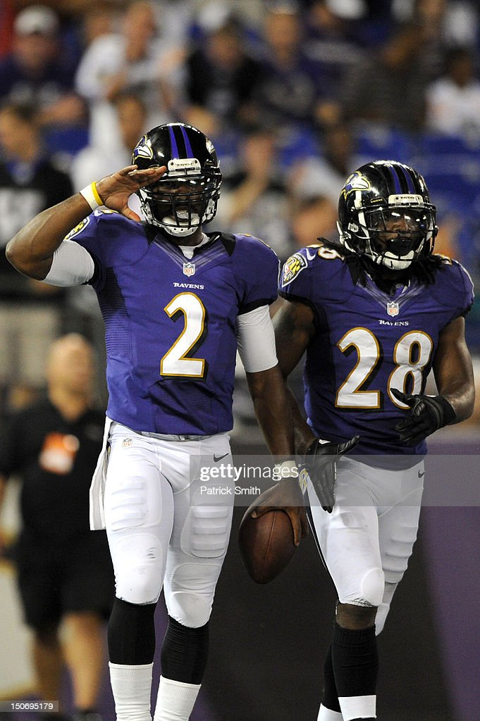 Quarterback Tyrod Taylor #2 of the Baltimore Ravens celebrates after scoring a touchdown against the Jacksonville Jaguars during the preseason game at M&T Bank Stadium on August 23, 2012 in Baltimore, Maryland. The Baltimore Ravens won 48-17.