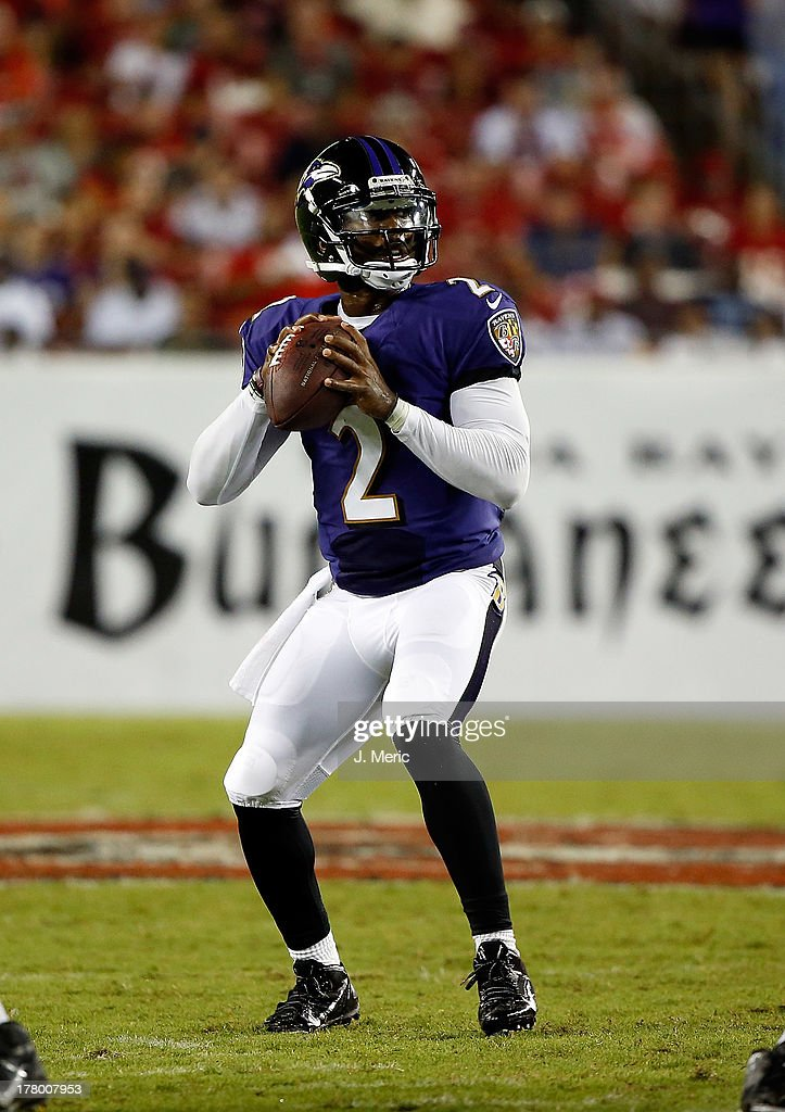 Quarterback <a gi-track='captionPersonalityLinkClicked' href=/galleries/search?phrase=Tyrod+Taylor&family=editorial&specificpeople=4489709 ng-click='$event.stopPropagation()'>Tyrod Taylor</a> #2 of the Baltimore Ravens looks for an open receiver against the Tampa Bay Buccaneers during a preseason game at Raymond James Stadium on August 8, 2013 in Tampa, Florida.