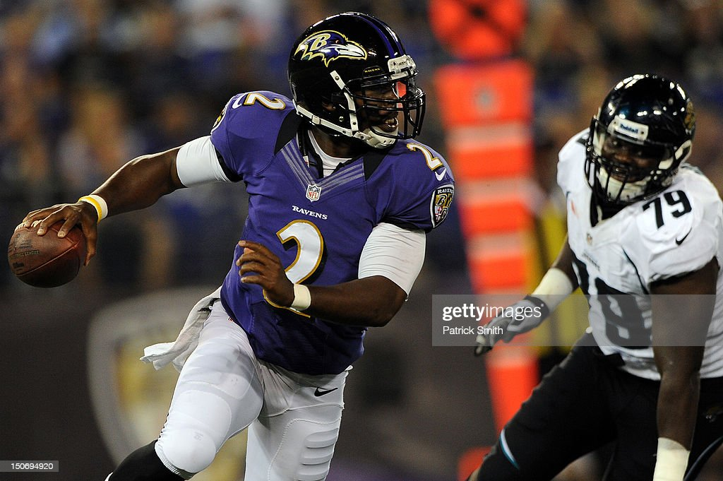 Quarterback Tyrod Taylor #2 of the Baltimore Ravens rushes against the Jacksonville Jaguars during the preseason game at M&T Bank Stadium on August 23, 2012 in Baltimore, Maryland. The Baltimore Ravens won 48-17.