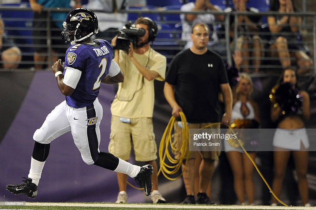 Quarterback Tyrod Taylor #2 of the Baltimore Ravens rushes for a touchdown against the Jacksonville Jaguars during the preseason game at M&T Bank Stadium on August 23, 2012 in Baltimore, Maryland. The Baltimore Ravens won 48-17.