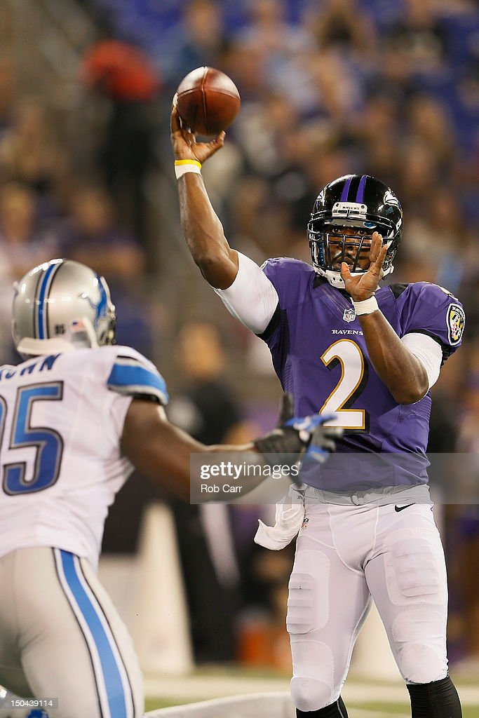 Quarterback <a gi-track='captionPersonalityLinkClicked' href=/galleries/search?phrase=Tyrod+Taylor&family=editorial&specificpeople=4489709 ng-click='$event.stopPropagation()'>Tyrod Taylor</a> #2 of the Baltimore Ravens throws a pass over <a gi-track='captionPersonalityLinkClicked' href=/galleries/search?phrase=Everette+Brown&family=editorial&specificpeople=2901550 ng-click='$event.stopPropagation()'>Everette Brown</a> #95 of the Detroit Lions during the second half at M&T Bank Stadium on August 17, 2012 in Baltimore, Maryland.