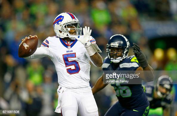 Quarterback Tyrod Taylor of the Buffalo Bills is pressured by defensive end Cliff Avril of the Seattle Seahawks at CenturyLink Field on November 7...
