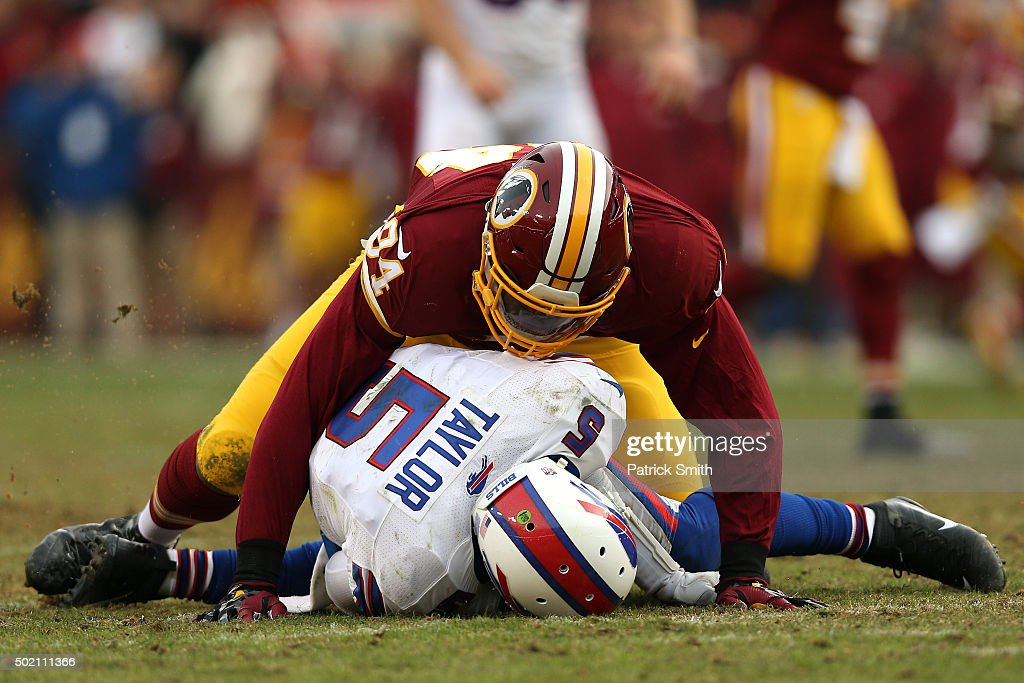 Quarterback Tyrod Taylor of the Buffalo Bills is sacked by linebacker Preston Smith of the Washington Redskins in the fourth quarter at FedExField on...
