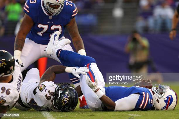 Quarterback Tyrod Taylor of the Buffalo Bills is sacked by linebacker Matt Judon of the Baltimore Ravens in the first quarter during a preseason game...
