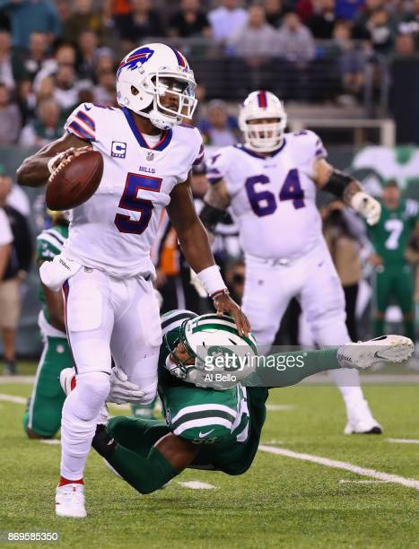 Quarterback Tyrod Taylor of the Buffalo Bills is sacked by outside linebacker Jordan Jenkins and inside linebacker Darron Lee of the New York Jets...