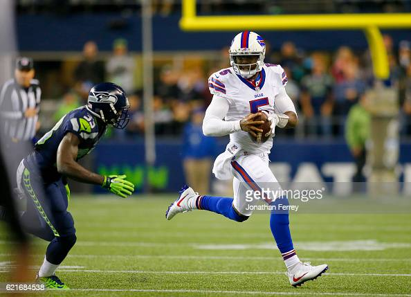 Quarterback Tyrod Taylor of the Buffalo Bills runs away from the Seattle Seahawks defense at CenturyLink Field on November 7 2016 in Seattle...