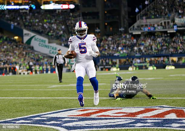 Quarterback Tyrod Taylor of the Buffalo Bills takes it in for a touchdown against linebacker Brock Coyle of the Seattle Seahawks at CenturyLink Field...