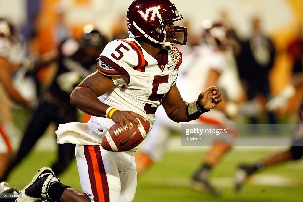 Quarterback Tyrod Taylor of the Virginia Tech Hokies runs the ball against the Cincinnati Bearcats during the FedEx Orange Bowl at Dolphin Stadium on...