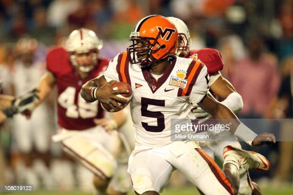 Quarterback Tyrod Taylor of the Virginia Tech Hokies runs with the ball against the Stanford Cardinal during the 2011 Discover Orange Bowl at Sun...
