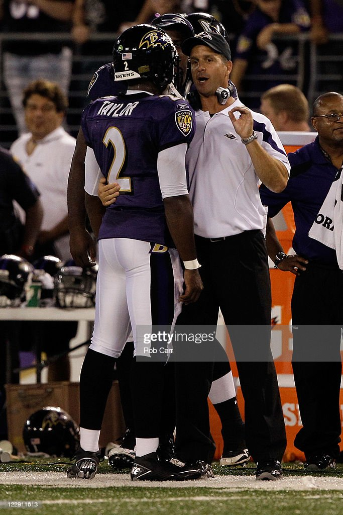 Quarterback Tyrod Taylor #2 talks with head coach John Harbaugh of the Baltimore Ravens during the second half of a preseason game against the Washington Redskins at M&T Bank Stadium on August 25, 2011 in Baltimore, Maryland. The Ravens defeated the Redskins 34-31.