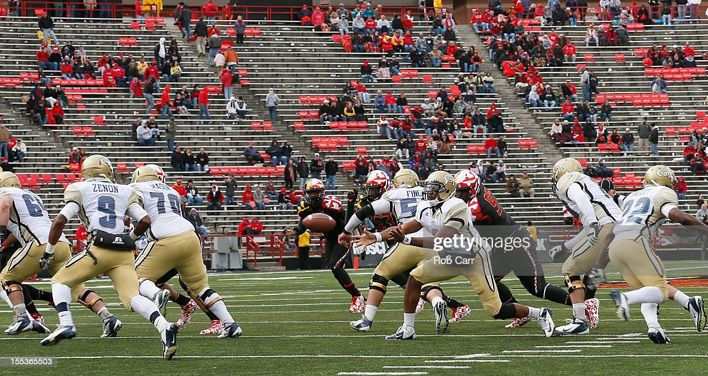 Quarterback Vad Lee #2 of the Georgia Tech Yellow Jackets pitches the ball to running back Tony Zenon #9 during the closing moments of the Yellow Jackets 33-13 win over the Maryland Terrapins at Byrd Stadium on November 3, 2012 in College Park, Maryland.