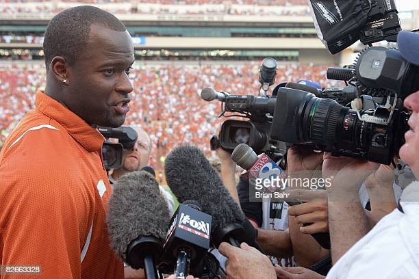 Quarterback Vince Young of the Tennessee Titans speaks to the media after his Texas Longhorns jersey number is retired before a game against the...