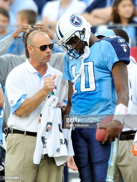 Quarterback Vince Young of the Tennessee Titans talks with a member of the training staff after leaving a game against the Washington Redskins at LP...