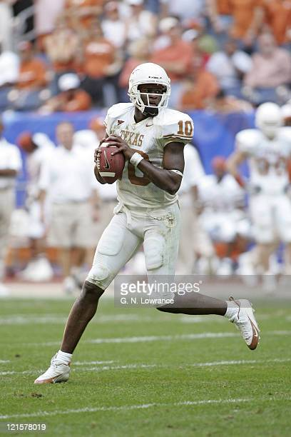 Quarterback Vince Young of the Texas Longhorns looks for a receiver against the Colorado Buffalos in the Big 12 Championship at Reliant Stadium in...