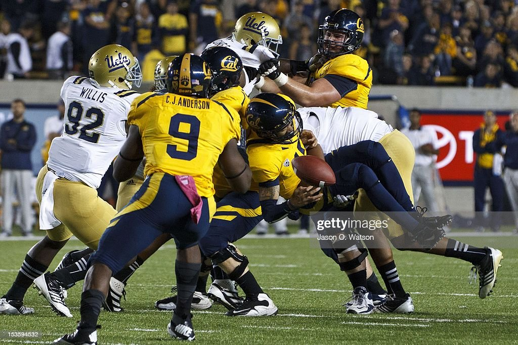 Quarterback Zach Maynard #15 of the California Golden Bears fumbles the ball after being hit by linebacker Anthony Barr #11 of the UCLA Bruins (right) during the first quarter at California Memorial Stadium on October 6, 2012 in Berkeley, California.
