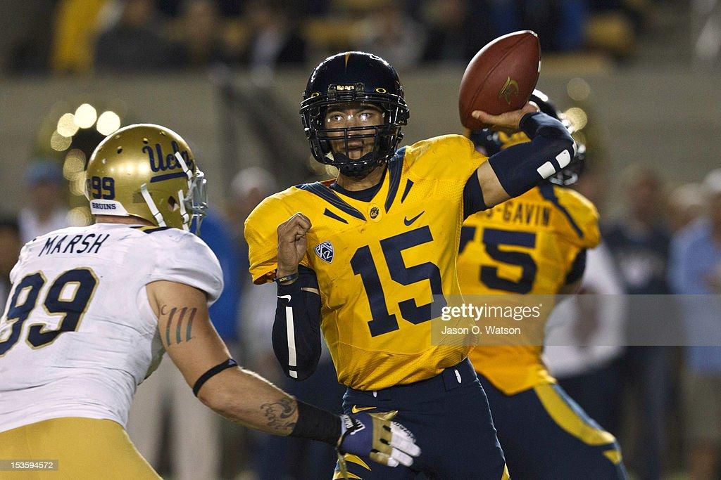 Quarterback Zach Maynard #15 of the California Golden Bears passes over defensive end Cassius Marsh #99 of the UCLA Bruins during the second quarter at California Memorial Stadium on October 6, 2012 in Berkeley, California.