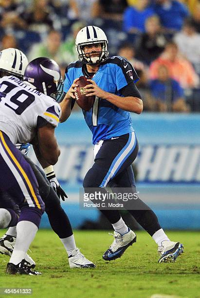 Quarterback Zach Mettenberger of the Tennessee Titans looks for a receiver during a preseason game against the Minnesota Vikings at LP Field on...