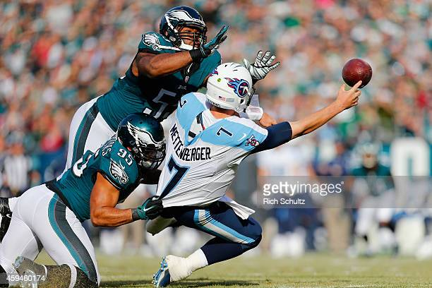 Quarterback Zach Mettenberger of the Tennessee Titans makes an incomplete pass against Mychal Kendricks and Brandon Graham of the Philadelphia Eagles...