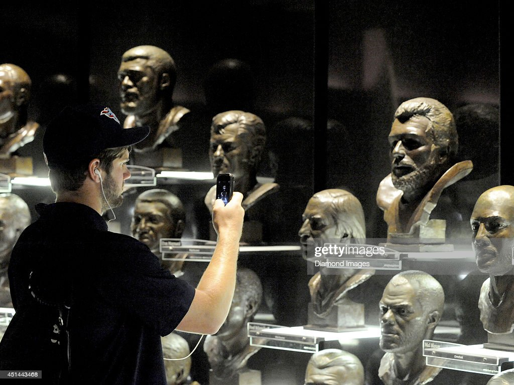 Quarterback Zach Mettenberger of the Tennessee Titans takes a picture of Hall of Fame quarterback Dan Fouts as part of a visit to the Pro Football Hall of Fame in Canton, Ohio during the 2014 NFL Rookie Symposium on June 28, 2014.