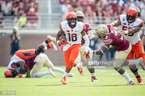 Quarterback Zack Mahoney of the Syracuse Orange carries the ball past defensive back Derwin James of the Florida State Seminoles on October 31 2015...