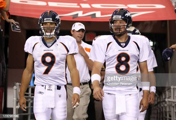 Quarterbacks Brady Quinn and Kyle Orton of the Denver Broncos walk out onto the field for warm ups to the preseason NFL game against the Arizona...