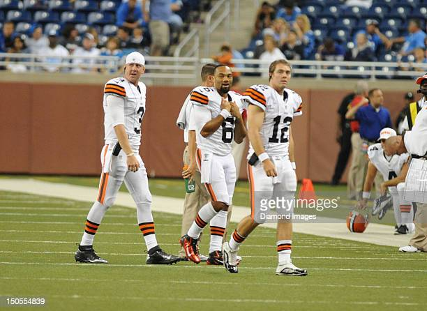 Quarterbacks Brandon Weeden Colt McCoy and Seneca Wallace of the Cleveland Browns walks to the sideline during a game with the Detroit Lions at Ford...