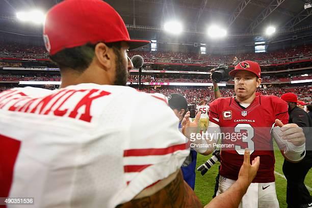 Quarterbacks Carson Palmer of the Arizona Cardinals and Colin Kaepernick of the San Francisco 49ers shake hands following the NFL game at the...