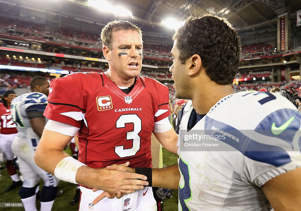 Quarterbacks Carson Palmer #3 of the Arizona Cardinals and Russell Wilson #3 of the Seattle Seahawks shake hands following the NFL game at the University of Phoenix Stadium on October 17, 2013 in Glendale, Arizona. The Seahawks defeated the Cardinals 34-22.