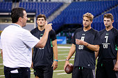 Quarterbacks Christian Hackenberg of Penn State Jared Goff of California and Jeff Driskel of Louisiana Tech listen to a coach during the 2016 NFL...