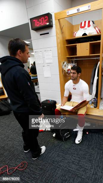 Quarterbacks Coach Rich Scangarello and Jimmy Garoppolo of the San Francisco 49ers talk in the locker room prior to the game against the Chicago...