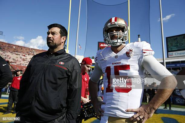 Quarterbacks Coach Ryan Day and Christian Ponder of the San Francisco 49ers stand on the field prior to the game against the Los Angeles Rams at the...