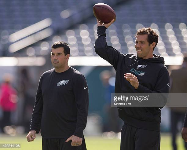 Quarterbacks coach Ryan Day looks on as Sam Bradford of the Philadelphia Eagles warms up prior to the game against the New Orleans Saints on October...