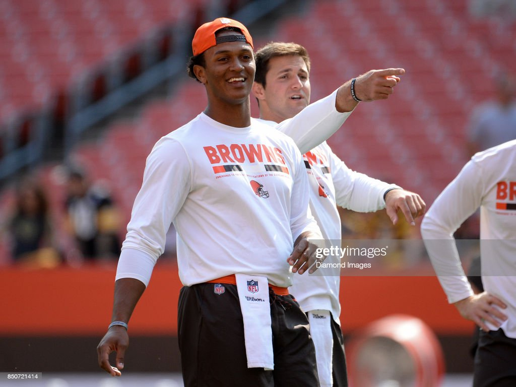 Quarterbacks DeShone Kizer #7 and Cody Kessler #6 of the Cleveland Browns smile as they take part in warm ups prior to a game on September 10, 2017 against the Pittsburgh Steelers at FirstEnergy Stadium in Cleveland, Ohio. Pittsburgh won 21-18.