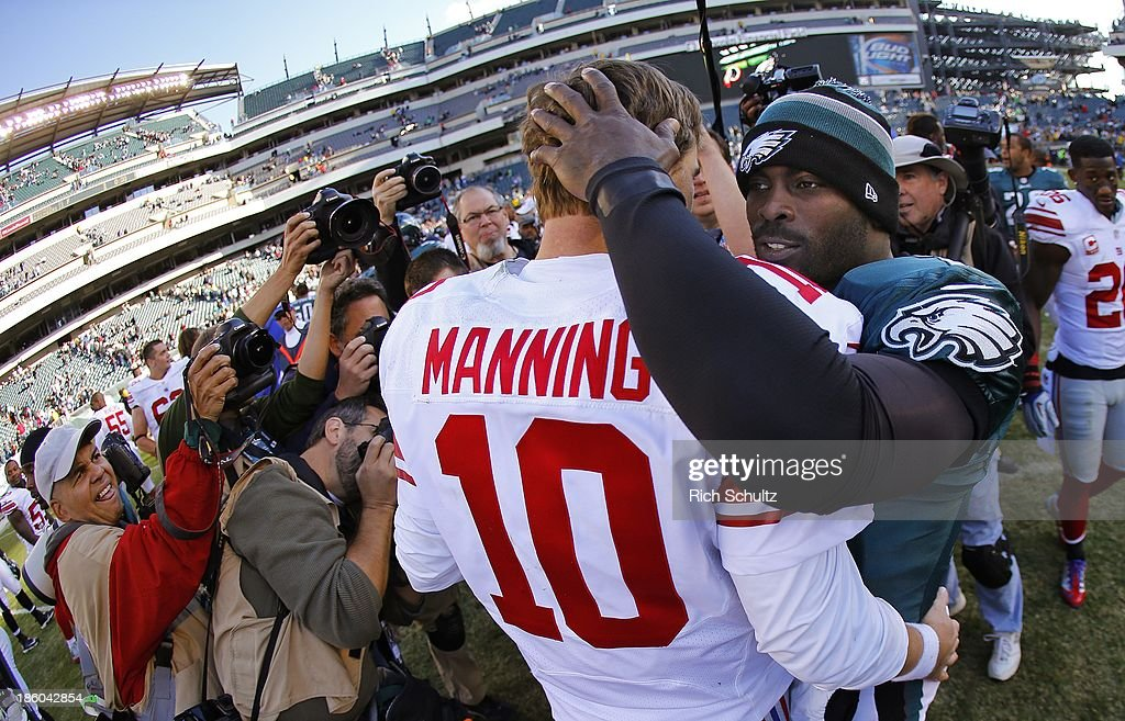 Quarterbacks <a gi-track='captionPersonalityLinkClicked' href=/galleries/search?phrase=Eli+Manning&family=editorial&specificpeople=202013 ng-click='$event.stopPropagation()'>Eli Manning</a> #10 of the New York Giants and <a gi-track='captionPersonalityLinkClicked' href=/galleries/search?phrase=Michael+Vick&family=editorial&specificpeople=201746 ng-click='$event.stopPropagation()'>Michael Vick</a> #7 of the Philadelphia Eagles hug after g a game at Lincoln Financial Field on October 27, 2013 in Philadelphia, Pennsylvania. The Giants defeated the Eagles 15-7.