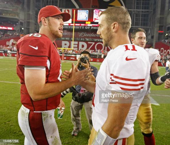 Quarterbacks John Skelton of the Arizona Cardinals and Alex Smith of the San Francisco 49ers greet each other at midfield during the end of an NFL...