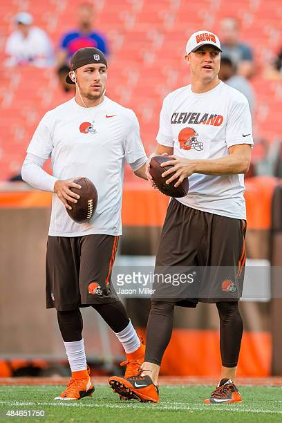 Quarterbacks Johnny Manziel and Josh McCown of the Cleveland Browns warm up prior to a preseason game against the Buffalo Bills at FirstEnergy...