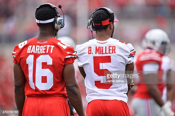 Quarterbacks JT Barrett of the Ohio State Buckeyes and Braxton Miller of the Ohio State Buckeyes who are both injured watch their teammates during...