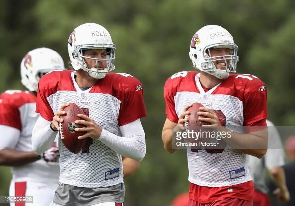 Quarterbacks Kevin Kolb and John Skelton of the Arizona Cardinals drop back to pass during the team training camp at Northern Arizona University on...