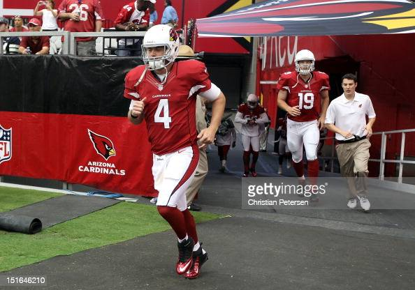 Quarterbacks Kevin Kolb and John Skelton of the Arizona Cardinals run out onto the field before their season opener against the Seattle Seahawks at...