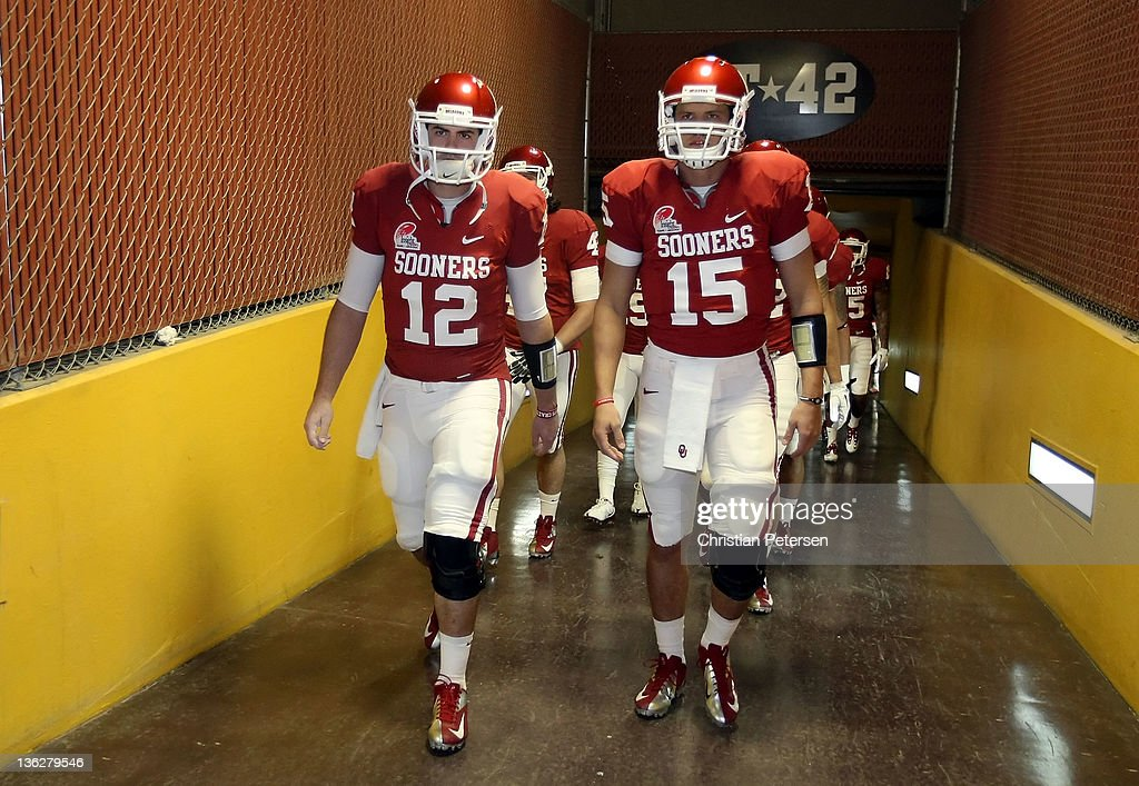 Quarterbacks <a gi-track='captionPersonalityLinkClicked' href=/galleries/search?phrase=Landry+Jones&family=editorial&specificpeople=5572476 ng-click='$event.stopPropagation()'>Landry Jones</a> #12 and Drew Allen #15 of the Oklahoma Sooners walk out onto the field before the Insight Bowl against the Iowa Hawkeyes at Sun Devil Stadium on December 30, 2011 in Tempe, Arizona.