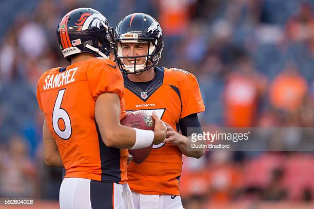 Quarterbacks Mark Sanchez and Trevor Siemian talk on the field during player warm ups before a preseason NFL game against the San Francisco 49ers at...