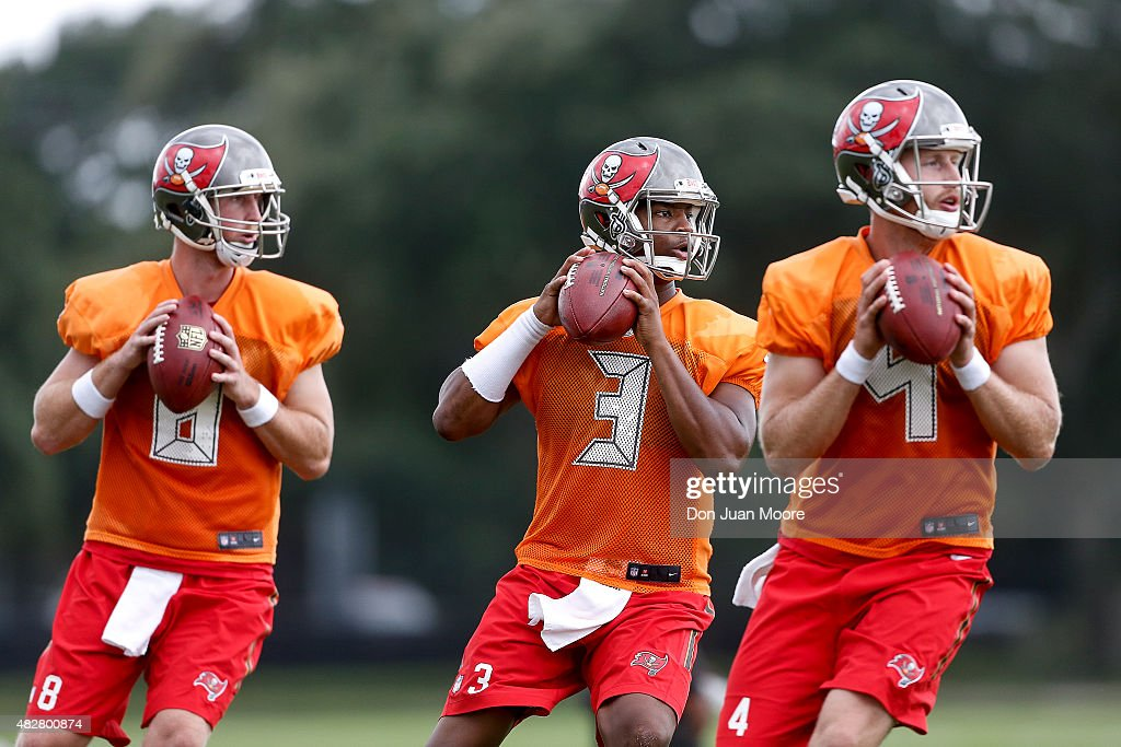 Quarterbacks <a gi-track='captionPersonalityLinkClicked' href=/galleries/search?phrase=Mike+Glennon+-+American+football-speler&family=editorial&specificpeople=11404080 ng-click='$event.stopPropagation()'>Mike Glennon</a> #8, <a gi-track='captionPersonalityLinkClicked' href=/galleries/search?phrase=Jameis+Winston&family=editorial&specificpeople=8772860 ng-click='$event.stopPropagation()'>Jameis Winston</a> #3 and Seth Lobato #4 of the Tampa Bay Buccaneers work on some drills during Training Camp at One Buc Place on August 2, 2015 in Tampa, Florida.