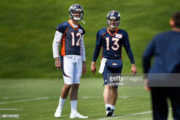 Quarterback's Paxton Lynch and Trevor Siemian of the Denver Broncos during the first week of OTAs at the UCHealth Training Center May 23 2017 in...