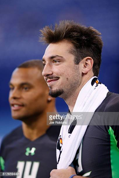 Quarterbacks Paxton Lynch of Memphis and Dak Prescott of Mississippi State look on during the 2016 NFL Scouting Combine at Lucas Oil Stadium on...