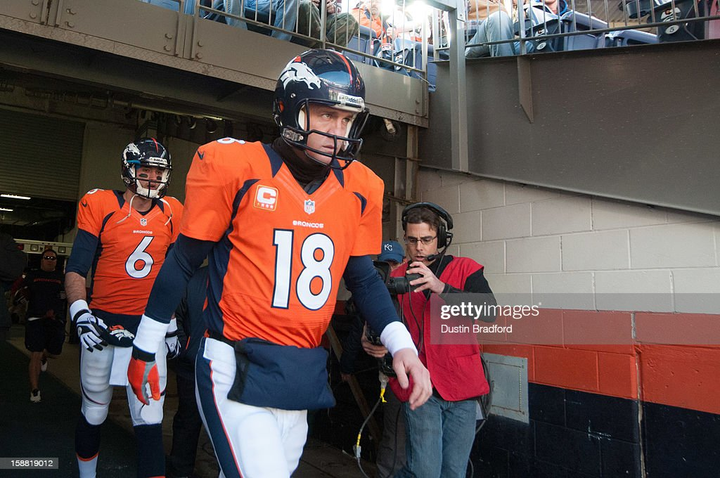 Quarterbacks Peyton Manning #18 Brock Osweiler #6 of the Denver Broncos emerge from the locker room for pre-game warm ups before a game against the Kansas City Chiefs at Sports Authority Field Field at Mile High on December 30, 2012 in Denver, Colorado.